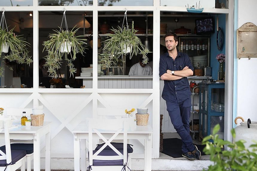 SMU associate professor Kyriakos Mouratidis says his parents, who are back home in Greece, have been affected by pension cuts. Mr Christos Parlapanis, operations manager of Greek restaurant Blu Kouzina, struggled to find a job in Greece and came here