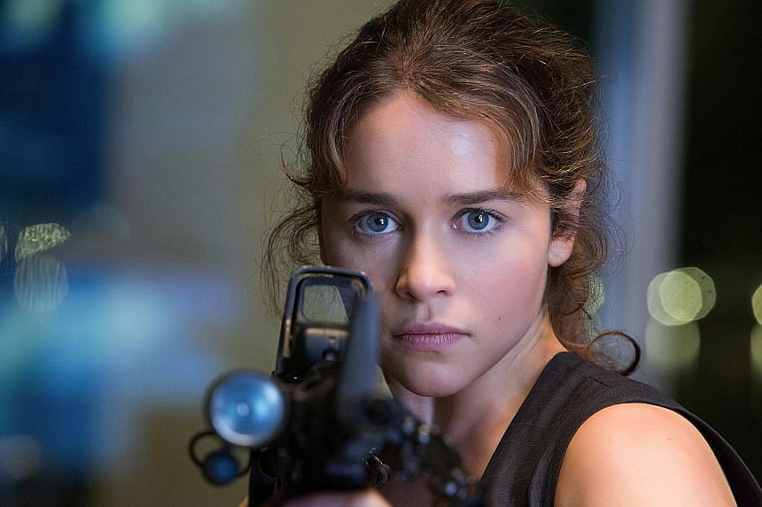 Emilia Clarke (right) fights to save the world as Sarah Conner (above) in Terminator Genisys.