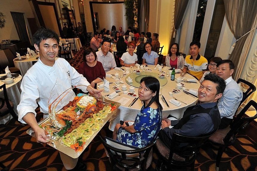 The 15 winners of ST170 Treats and their dining partners got to enjoy a meal co-curated by Jade Restaurant's chef Leong Chee Yeng (foreground, left) and Straits Times food critic Wong Ah Yoke (foreground, right).
