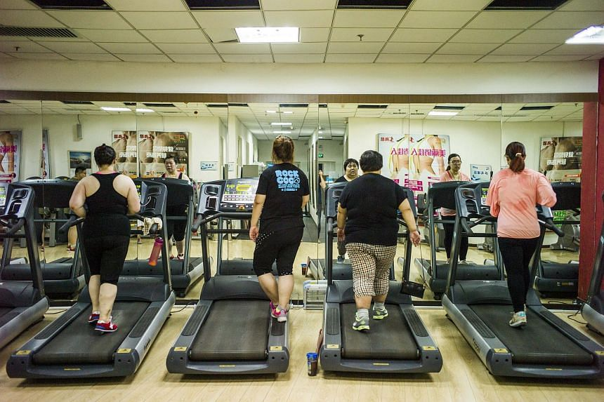 Overweight people having exercise treatment at the Aimin (Love the People) Fat Reduction Hospital in the northern port city of Tianjin on May 25, 2015.