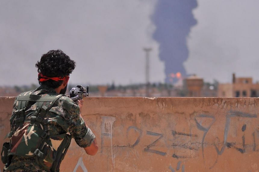 A Kurdish People Protection Unit fighter in the Syrian city of Hasakeh.
