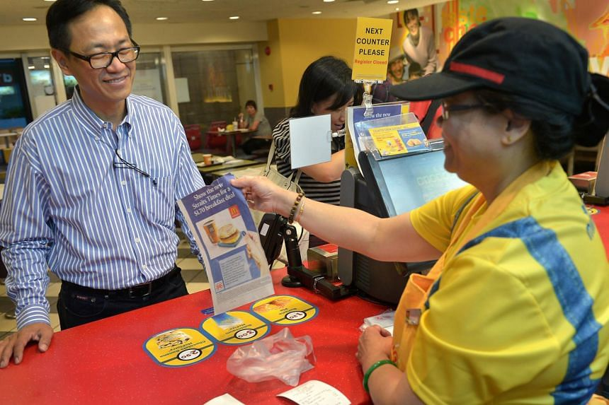 Architect Yeo Hock Chai, 55, redeeming his McDonald's promotional breakfast meal at Toa Payoh Central.