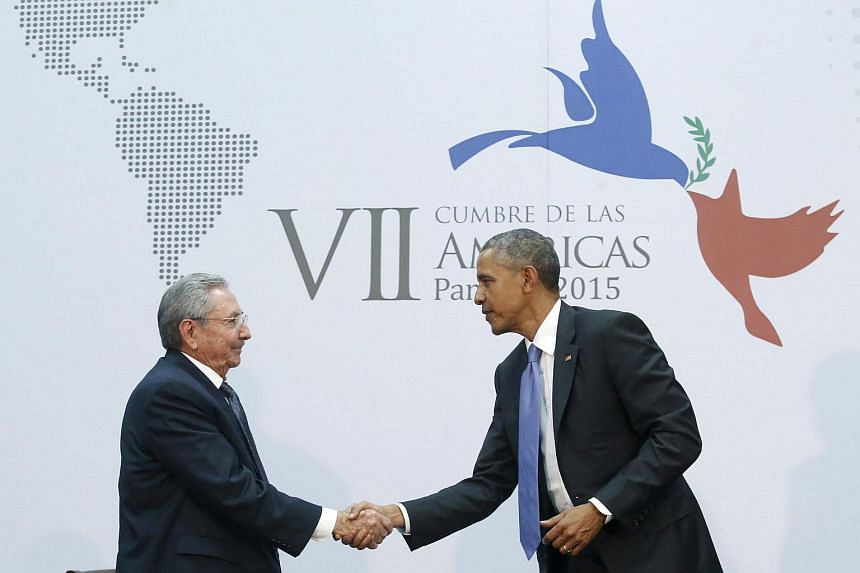 US President Barack Obama (right) shaking hands with his Cuban counterpart Raul Castro.