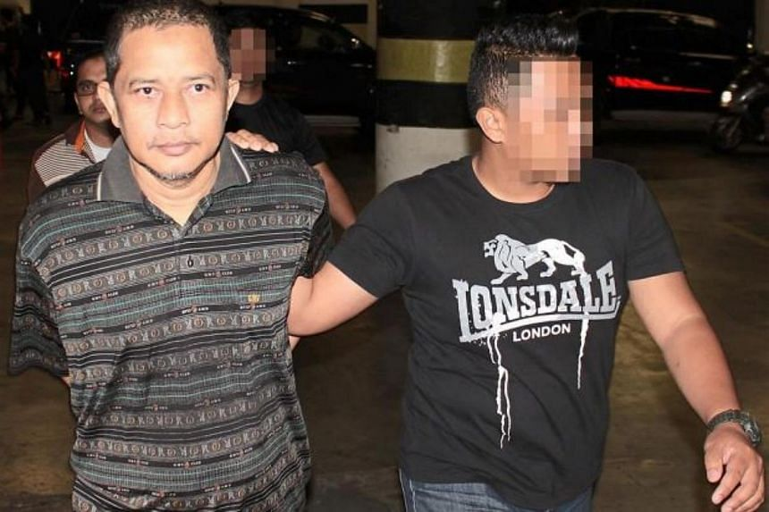 Murad Halimmuddin (left) and Abu Daud had planned to recruit at least 20 others to launch a terrorist movement in Malaysia.