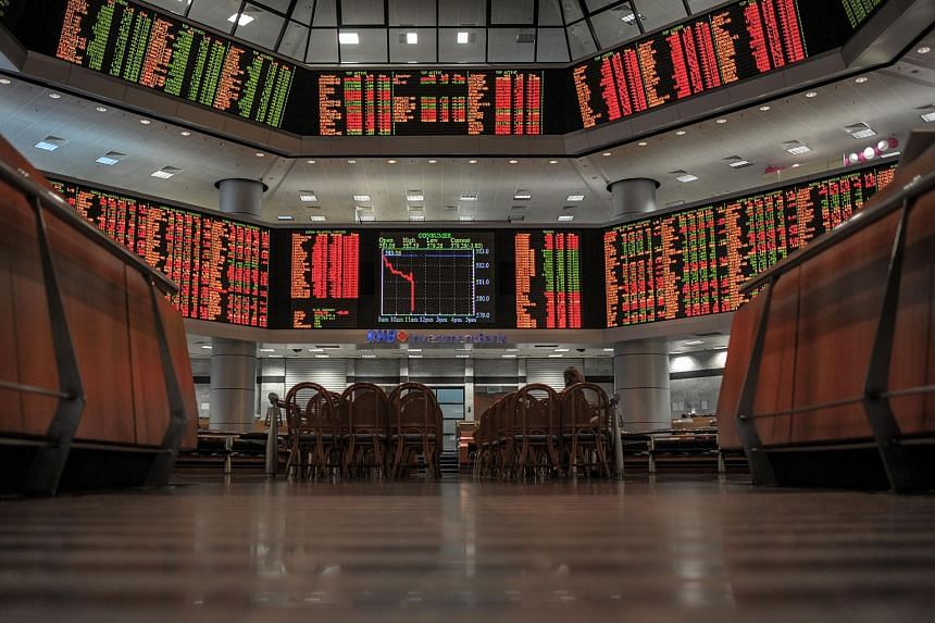 A general view shows electronic display boards providing information on stock movements at the Malaysia Stock Exchange in Kuala Lumpur.