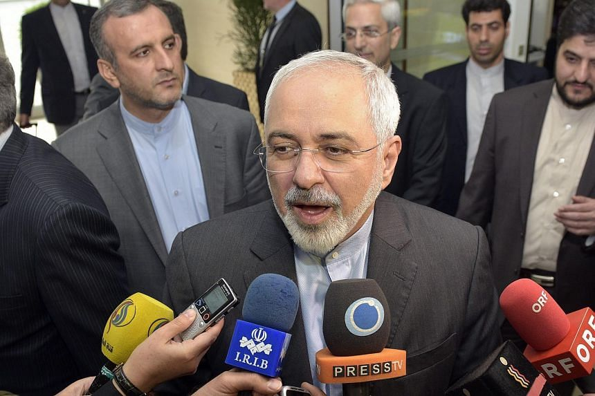 Iranian Foreign Minister Mohammad Javad Zarif speaking to the media at Vienna Airport.