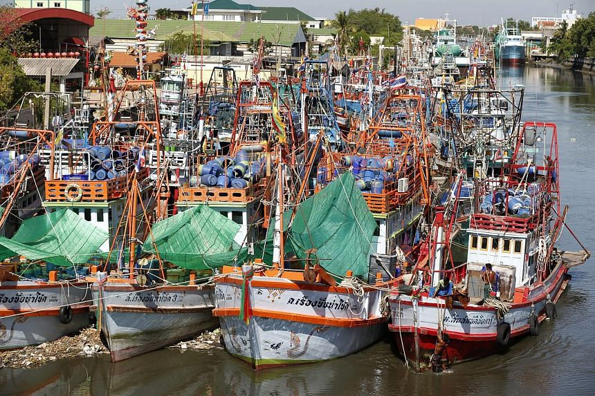 Fishing boats are docked after fishing operations stopped at a port in Samut Sakhon province, Thailand on July 1, 2015.