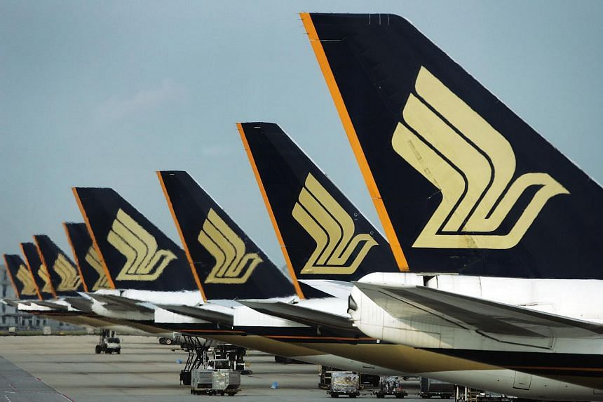 Singapore Airlines (SIA) airplanes at Changi Airport.