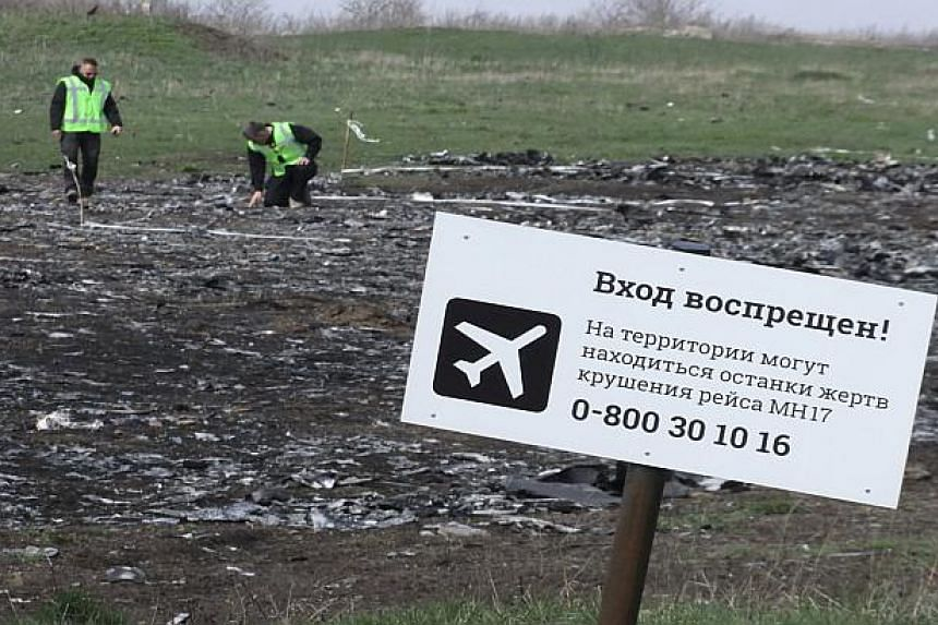 """A sign reads """"No entrance! There may be remains of the victims of flight MH17 crash""""."""