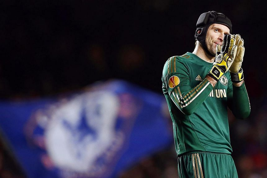 Former Chelsea goalkeeper Petr Cech applauding supporters in 2013.