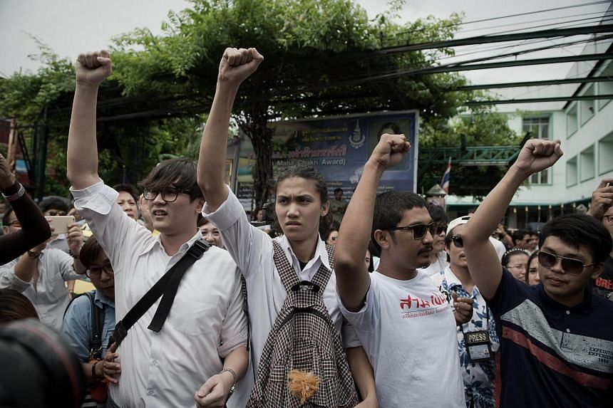 Supporters of anti-coup activists demonstrating outside a police station in Bangkok.