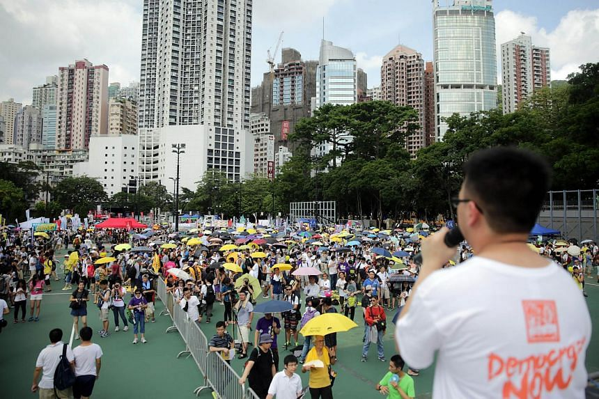 A pro-democracy speaker addresses the crowd during a rally at Victoria Park in Hong Kong on July 1, 2015.