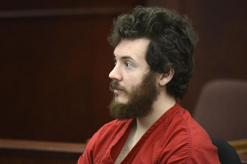 Accused Aurora theatre shooting suspect James Holmes listens at his arraignment in Centennial, Colorado on March 12, 2013.