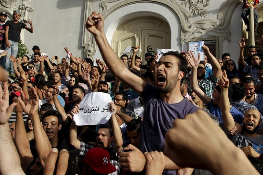 Tunisian protesters shout slogans during a demonstration demanding greater transparency of the oil sector at Avenue Habib-Bourguiba in Tunis, Tunisia, on May 30, 2015.