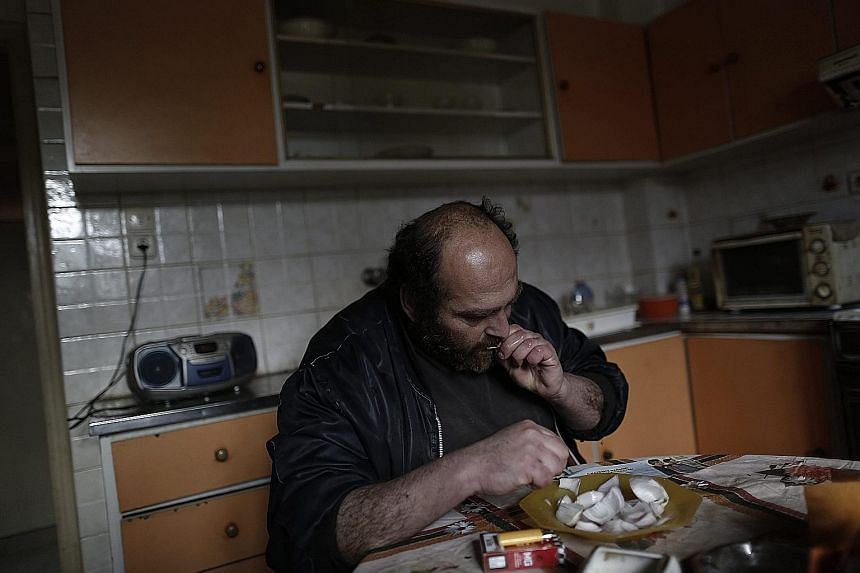 WHEN PENSION ENDS: For Mr Iakovos, 41, a home-cooked meal was still within reach when his mother was alive and drawing a pension. After she died in 2012, the Athens resident has been collecting aluminium cans but is unable to make a living. (Clockwis
