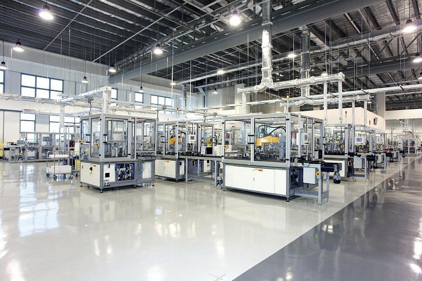 Dyson digital motor automated production lines, each with 50 robotic arms that assemble the motors, in its West Park plant in Tuas.