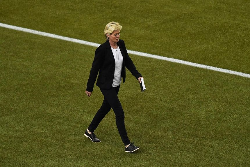 Germany's coach Silvia Neid returns to the field during the 2015 FIFA Women's World Cup in Montreal on June 30, 2015.