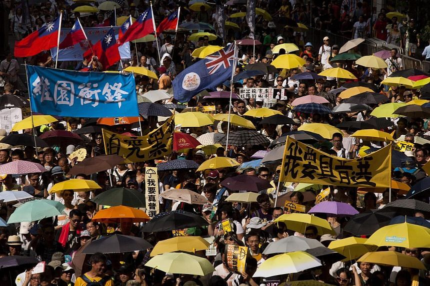 Protesters marching through the streets of Hong Kong during the annual pro-Democracy rally.
