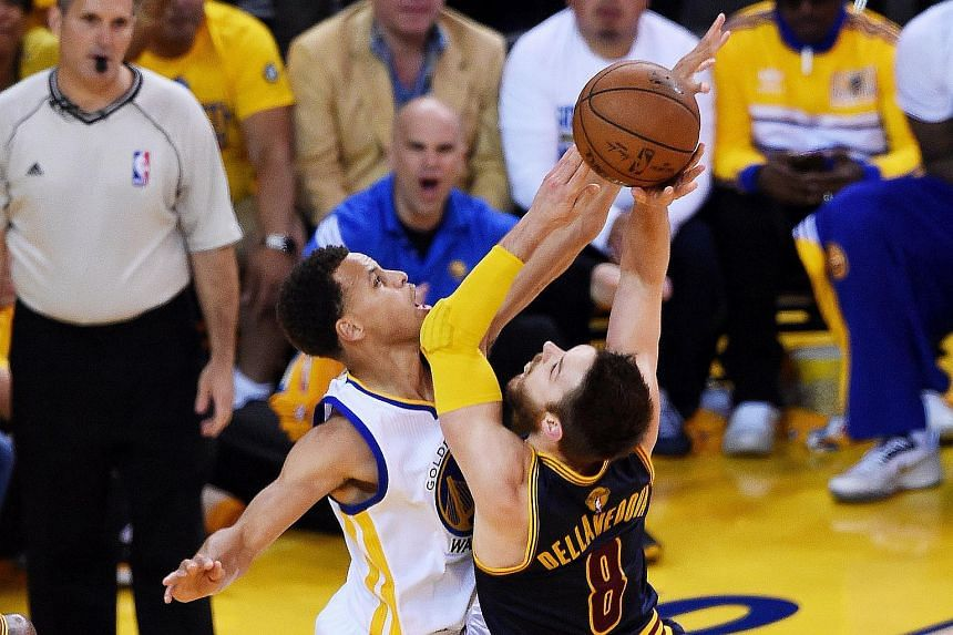 Matthew Dellavedova goes up against Stephen Curry during Game Five of the 2015 NBA Finals.