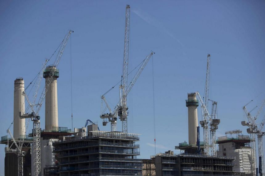 Construction cranes work near the former Battersea power station in London, Britain on June 4, 2015.