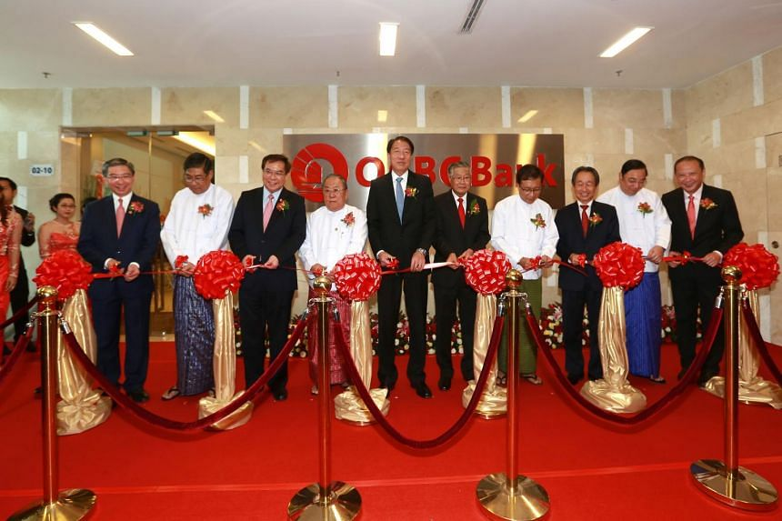 DPM Teo (centre) with dignitaries from the Singapore and Myanmar governments, and senior representatives from OCBC Bank at the official opening of OCBC Yangon Branch in Myanmar.