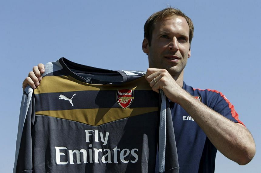 Czech soccer player Petr Cech shows his Arsenal jersey during his presentation in Prague July 1, 2015.