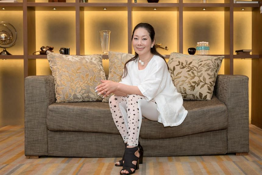 Madam Shigeyama Ai (above), who used to have brittle nails, attended a nail academy in Tokyo to improve on what was offered in salons. Her metallic gel polish range has a molten metal finish.