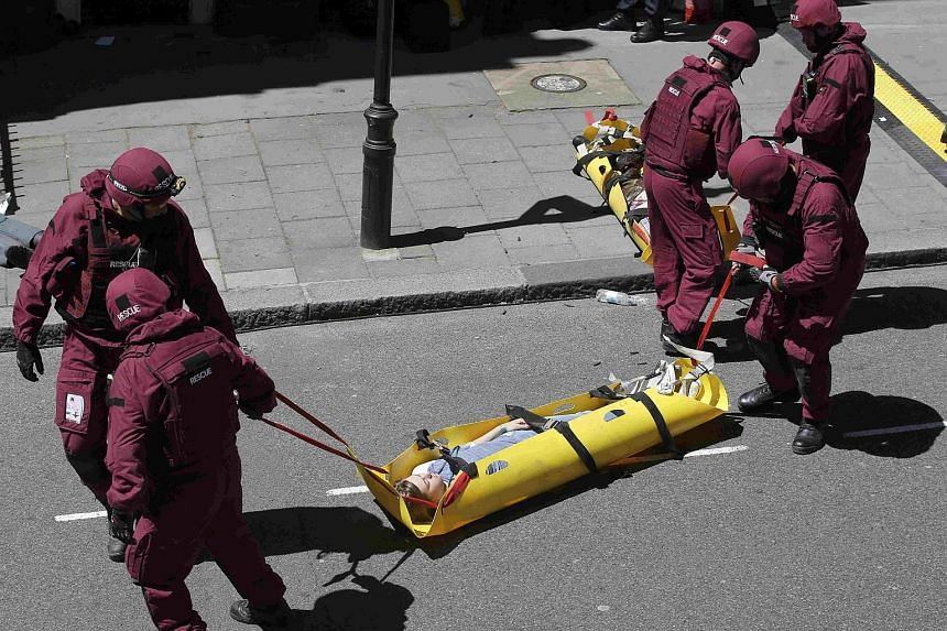 Members of the emergency services tend to a casualty during Exercise Strong Tower in central London.
