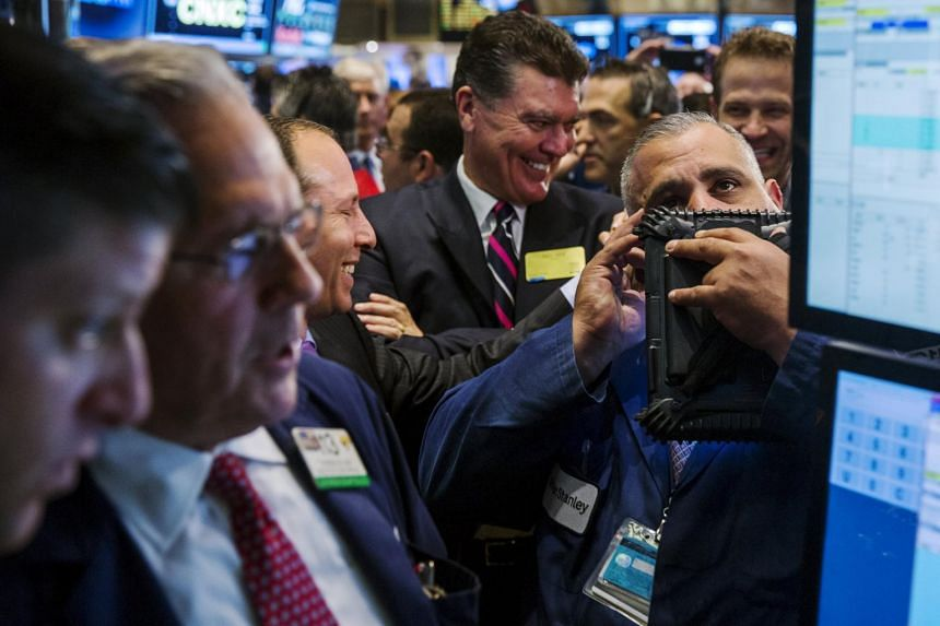 Traders work on the floor of the New York Stock Exchange shortly after the opening bell.