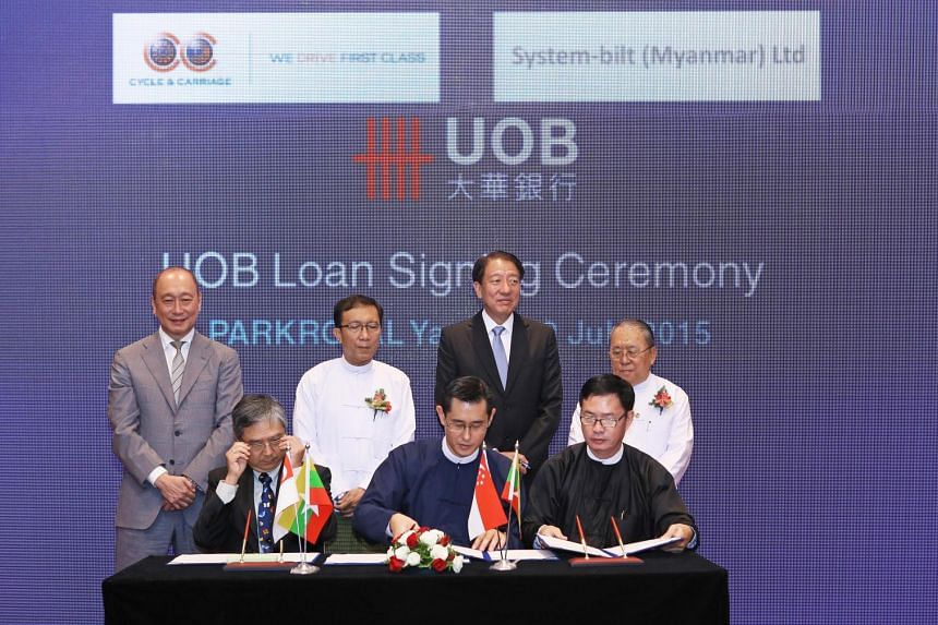 Mr Harry Loh, Country Manager of UOB Myanmar, in a loan signing ceremony with Mr Aye Tun, Director, Cycle & Carriage Automobile Myanmar Company and Mr Woo Siew Hin, Director of System-Bilt Myanmar. The signing ceremony was conducted in the presence o