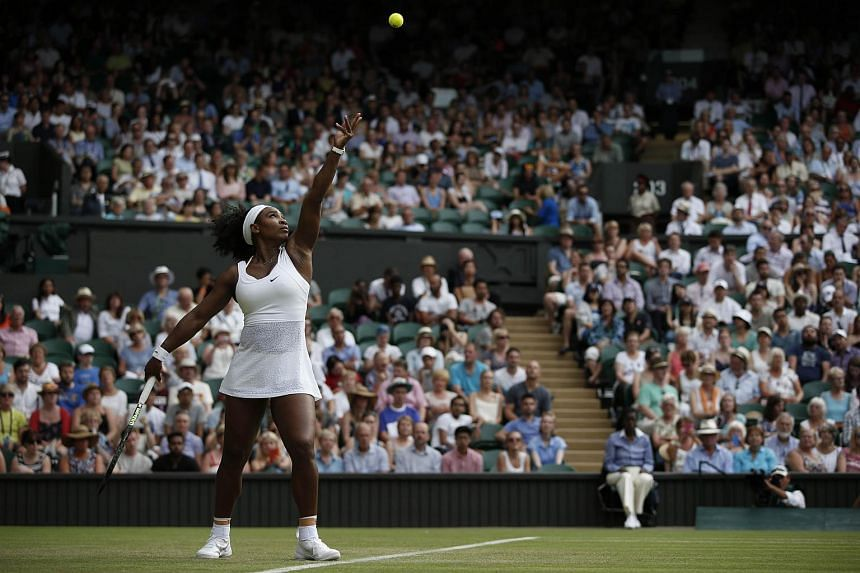 Serena Williams serves against Timea Babos on day three of the 2015 Wimbledon Championships.