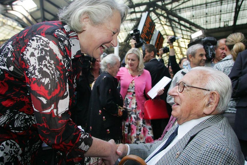 Sir Nicholas Winton (right) is greeted in 2009 by one of the many Jewish children he saved.