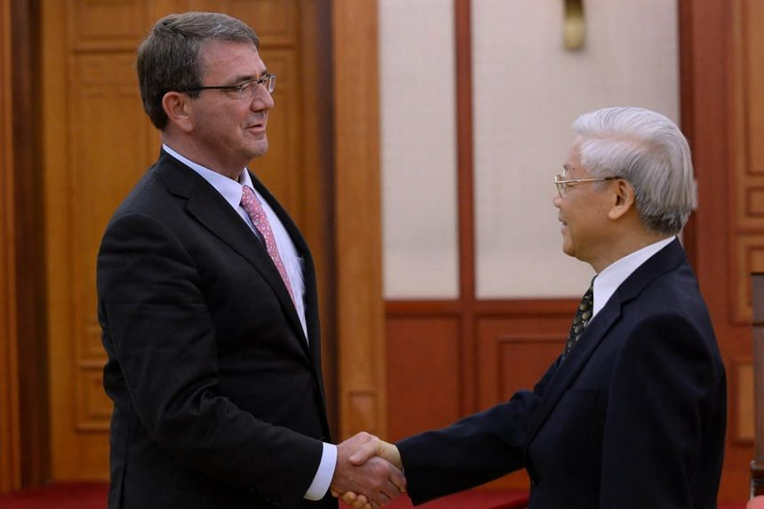 US Defense Secretary Ashton Carter (left) shakes hands with Vietnam Communist Party Secretary General Nguyen Phu Trong as they meet at the party headquarters in Hanoi on June 1, 2015.