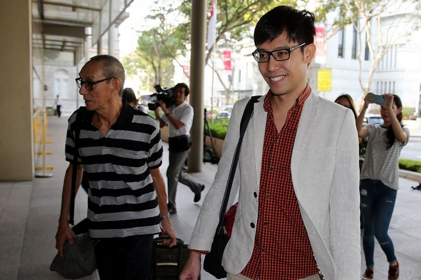 Blogger Roy Ngerng and his father arriving at court.