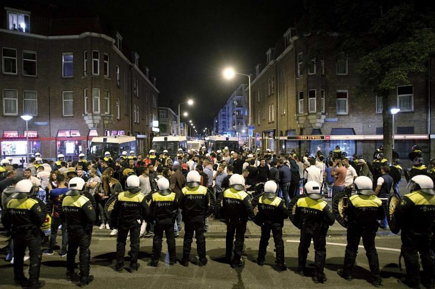 Dutch police on duty during a riot in the Schilderswijk district of The Hague, The Netherlands, on July 3, 2015.