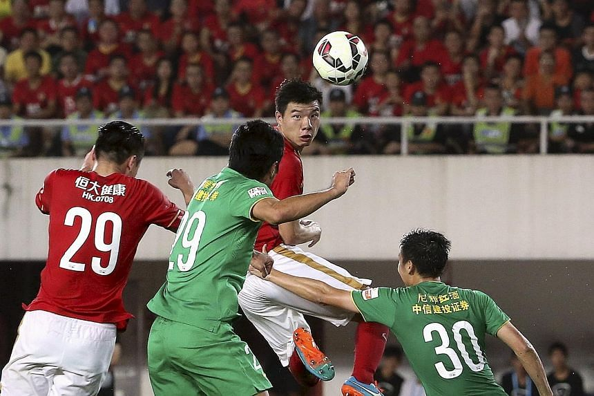 "Football team Guangzhou Evergrande Taobao (in red), which has filed with China's National Equities Exchange and Quotations to list on the so-called ""New Third Board"", could become the first club to be listed in Asia."