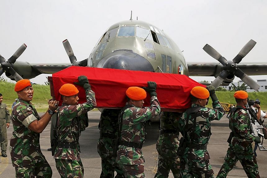 Indonesian soldiers carrying the coffin of a victim of the Hercules C130 crash on Wednesday. The air force's planes are mostly ageing, with many of its C130s hailing from the 1960s to 1980s.