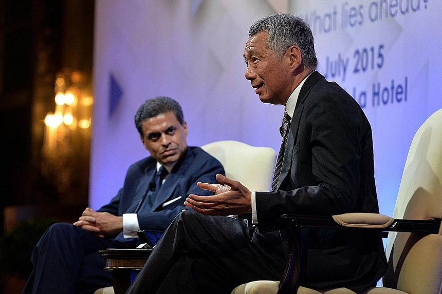 """PM Lee Hsien Loong at a dialogue hosted by columnist Fareed Zakaria at an Institute of Policy Studies conference yesterday. Asked by Mr Zakaria if Singapore needed to embrace a """"culture of disrespect"""" in order to become more economically vibrant, Mr"""