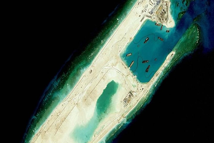 (Above) A picture from the US Navy purportedly showing Chinese dredging vessels in the waters around Fiery Cross Reef where the 3,000m airstrip is being built. (Left) Satellite images taken this year, showing the artificial island that was rapidly bu