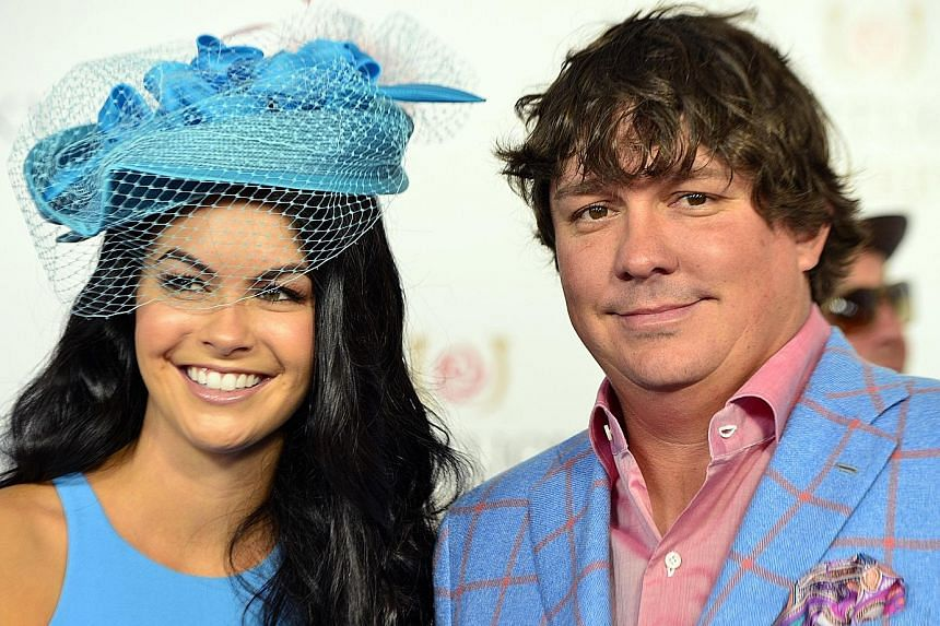 Amanda Boyd (left) and golfer Jason Dufner in happier days last year. The National Enquirer said Tiger Woods and Boyd had been dating for months and that he flew her to Seattle last month, ahead of the US Open.