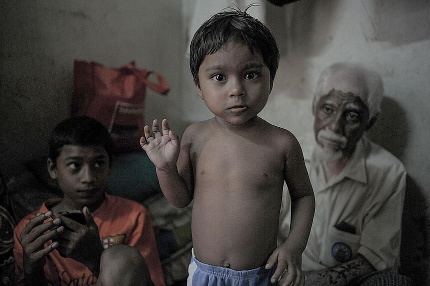 A Rohingya child inside a house in the suburbs of Kuala Lumpur. Malaysia has been the main destination for many illegal migrants.