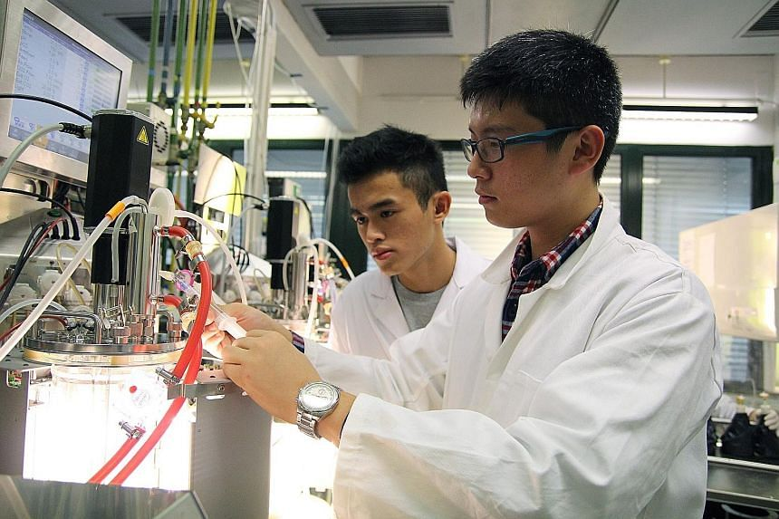 Students Indra Putra Kamsan (left) of Millennia Institute and Malcom Lau of Temasek Polytechnic working in a laboratory at the Technical University of Munich in Germany last month. During their stint, they carried out experiments under the supervisio