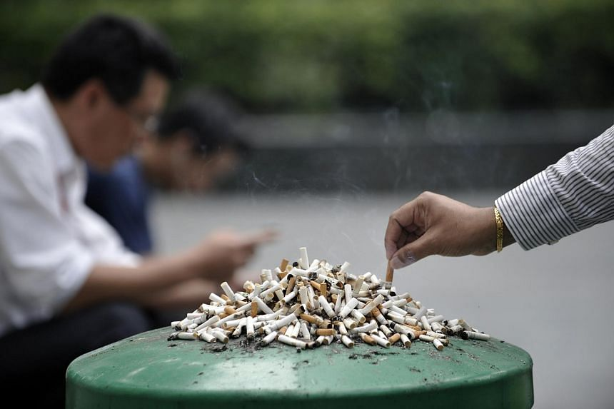 Stubbed-out cigarettes left on a dustbin.