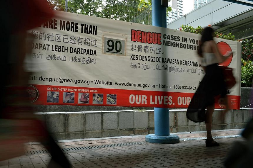 A poster on the number of dengue cases in the area put up near Somerset MRT station.