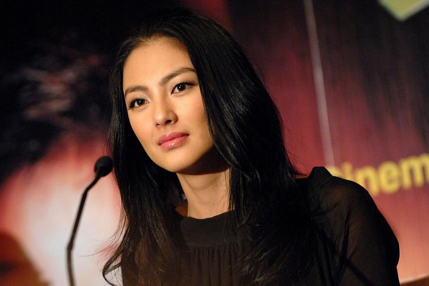 Chinese actress Kitty Zhang has announced the end of her four-year marriage to Golden Bear-winning director Wang Quan'an, less than a year after he was arrested for paying for sex.