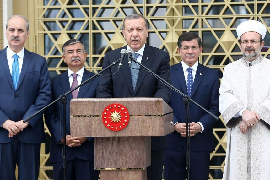 Turkish President Recep Tayyip Erdogan (centre) delivers a speech during the inauguration ceremony of the new Bestepe People's Mosque on July 3, 2015.