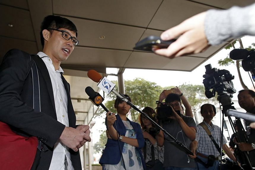 Blogger Roy Ngerng speaking to the media.
