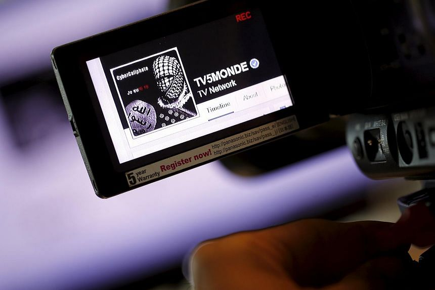 The hacked Facebook page of French television network TV5Monde is seen on a camera viewer in Paris on April 9, 2015.