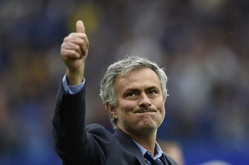 Chelsea manager Jose Mourinho celebrates after winning the Barclays Premier League.