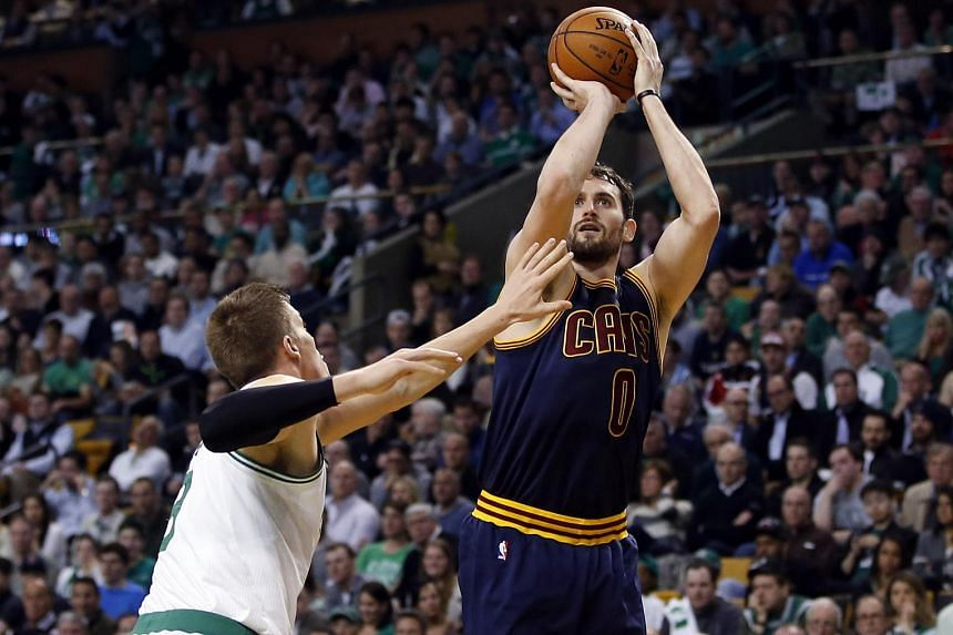 Cleveland Cavaliers forward Kevin Love (right) shoots against Boston Celtics forward Jonas Jerebko during the second half in game three of the first round of the NBA Playoffs at TD Garden.